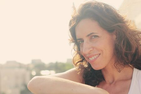 35 years: Portrait of beautiful 35 years old woman on sunset colors