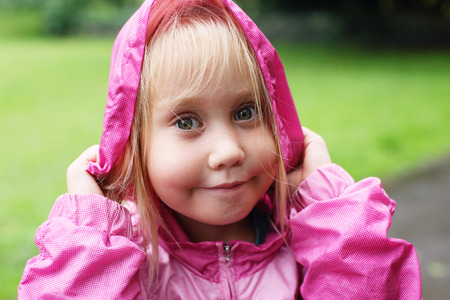 5 years old: funny portrait of aborable 5 years old girl outdoor