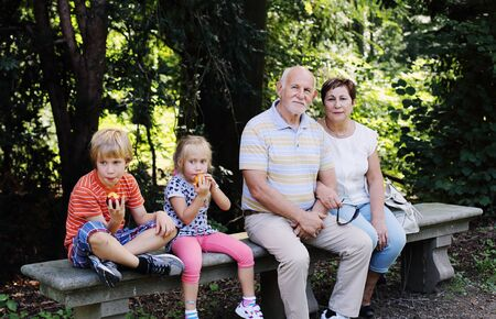 granny and grandad: Grandparents With Grandchildren walking together in the park