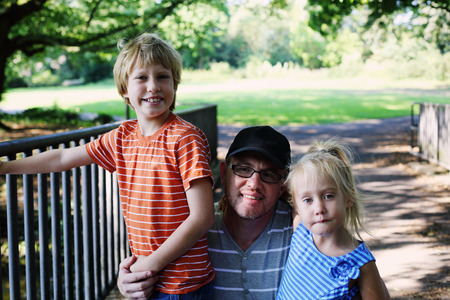 hapy: Outdoor portrait of hapy father with kids