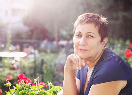 Portrait of happy smiling senior woman Standard-Bild