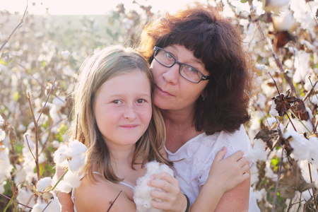 late forties: Portrait of mother and daughter outdoors