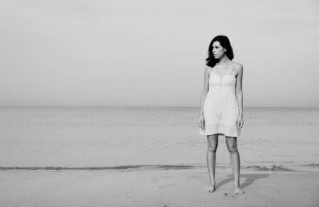 35 years old: beautiful 35 years old woman standing on the shore of the beach Stock Photo
