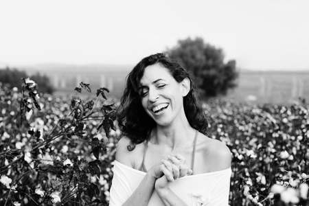 35 years old: Portrait of beautiful 35 years old woman standing in cotton field Stock Photo