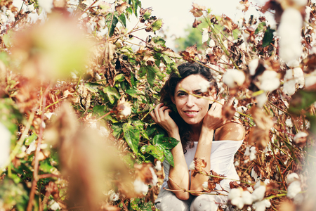 35 years: Portrait of beautiful 35 years old woman standing in cotton field Stock Photo