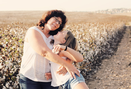 late 40s: Portrait of mother and daughter outdoors