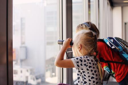 jungle boy: Happy kids with binoculars Stock Photo