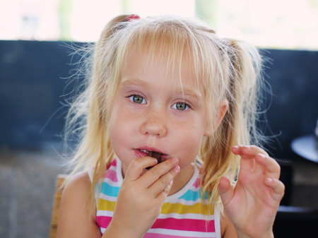 5 years old: Portrait of 5 years old girl eating choсolate Stock Photo