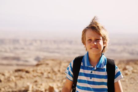 8 years: Cute 8 years old boy hiking in  the desert