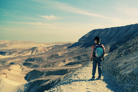 8 years old: Cute 8 years old boy hiking in  the desert
