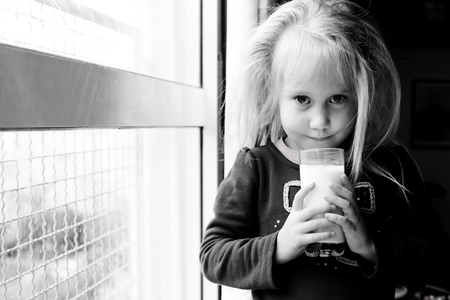 5 years old: 5 years old girl holding glass of milk