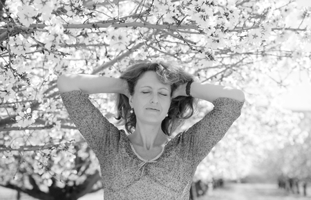 woman 40 years: Spring portrait of beautiful 40 years old woman outdoors Stock Photo