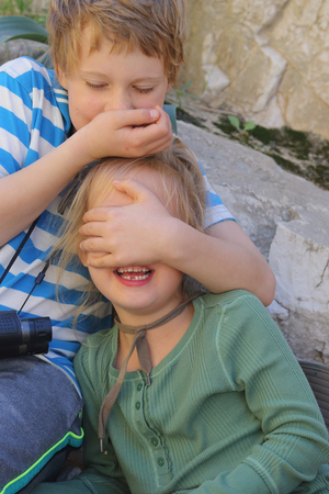 autistic: Portrait of happy girl with her autistic brother outdoors Stock Photo