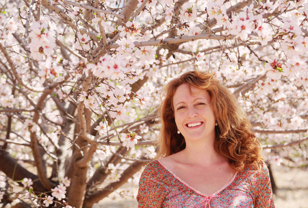 40: Spring portrait of beautiful 40 years old woman outdoors Stock Photo