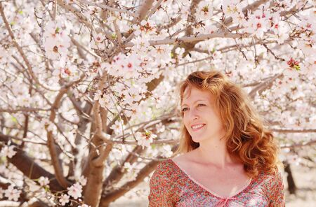 40 years: Spring portrait of beautiful 40 years old woman outdoors Stock Photo