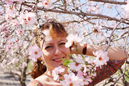 30 to 40 years: Spring portrait of beautiful 40 years old woman outdoors Stock Photo