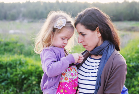 outdoor portrait of a beautiful middle aged mother and daughter photo