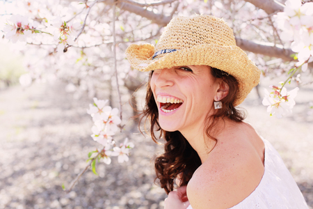 40 years old: Spring portrait of beautiful 40 years old woman outdoors Stock Photo