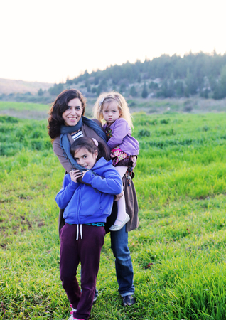 outdoor portrait of a beautiful middle aged mother and  her daughters photo