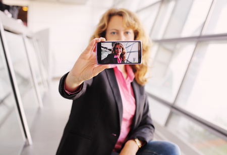 selfy: Beautiful businesswoman taking selfy picture on mobile device