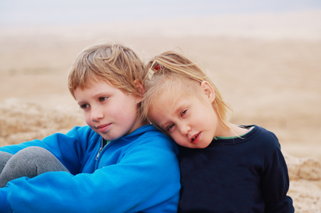 8 years: Portrait of 5 years girl with her autistic 8 years old brother outdoors Stock Photo