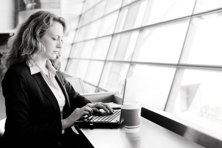 35 years old: Portrait of beautiful 35 years old woman with laptop Stock Photo
