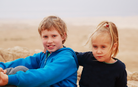 autistic: Portrait of 5 years girl with her autistic 8 years old brother outdoors Stock Photo