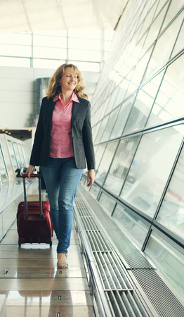 35 years old: Portrait of beautiful real 35 years old woman in airport
