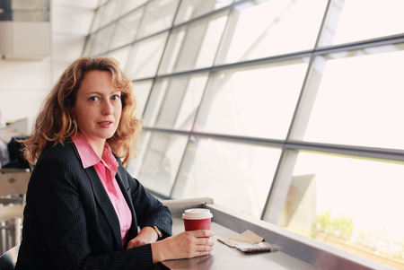 35 years old: Portrait of beautiful 35 years old woman with cup of coffee
