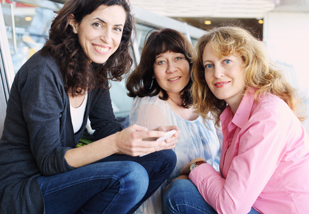 40 years old: Portrait of three smiling 40 years old women