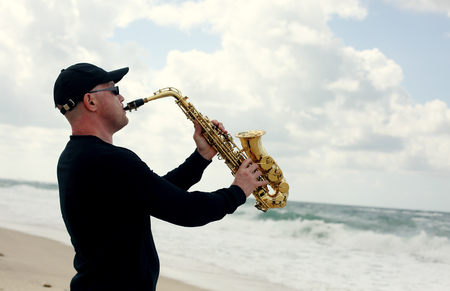 saxophonist: Saxophonist playing on saxophone outdoor Stock Photo