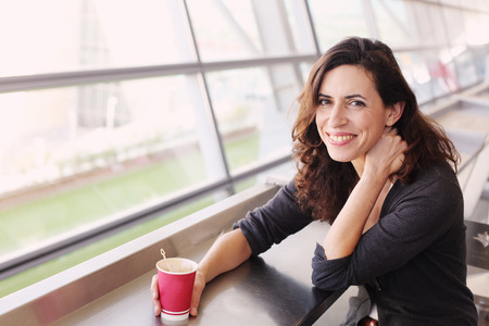 40 years old: Portrait of beautiful 40 years old woman holding cup of coffee Stock Photo
