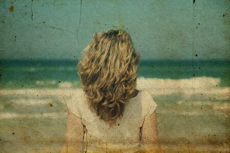 beautiful redhead: Beautiful redhead woman standing on the beach.