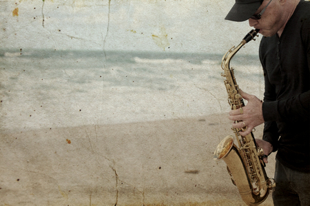 saxophonist: Saxophonist playing on saxophone outdoor. Old style photo. Stock Photo