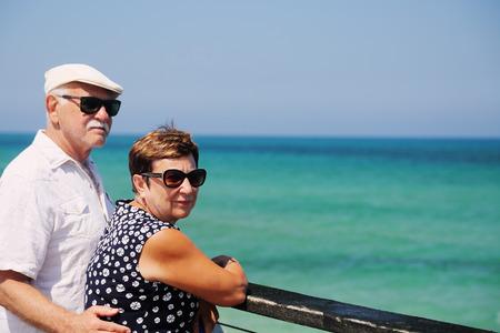 senior couple walking near the sea Stock Photo