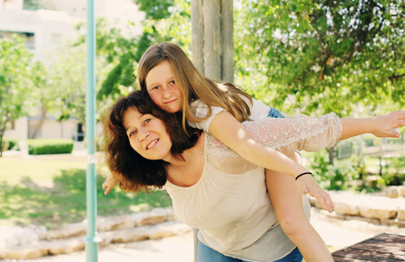 45 years old: Outdoor portrait of mother and daughter Stock Photo