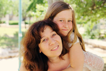 Outdoor portrait of mother and daughter Stock Photo
