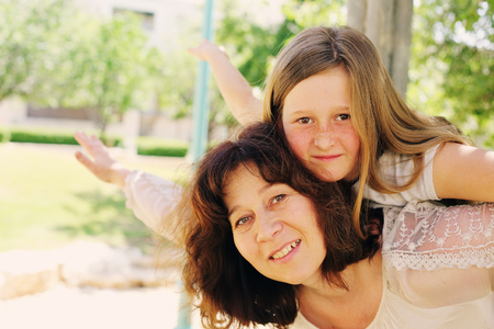 late 40s: Outdoor portrait of mother and daughter Stock Photo