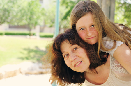 nine year old: Outdoor portrait of mother and daughter Stock Photo