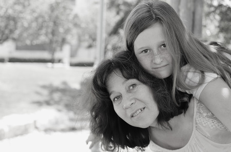 late forties: Outdoor portrait of mother and daughter Stock Photo