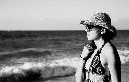 Beautifull 40 years old woman walking on the beach Stock Photo