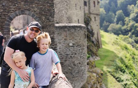 Portrait of father hiking with two kids in Germany photo