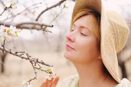 Happy woman in spring blossom park. soft backlight Stock Photo