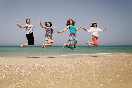 Portrait of four40 years old women on seaside