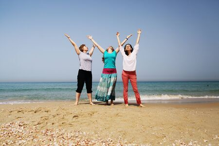 Portrait of three 40 years old women on seaside Stock Photo