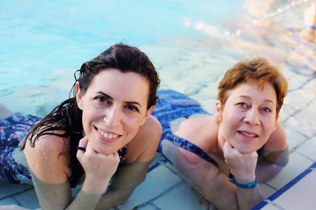 Portrait of two 40 years old women in swimming-pool Stock Photo
