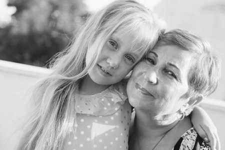Portrait of grandmother with 6 years old granddaughter photo
