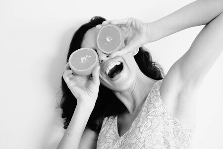 Portrait of 40 years old woman holding oranges photo