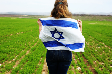 Woman holding an Israeli flag 写真素材
