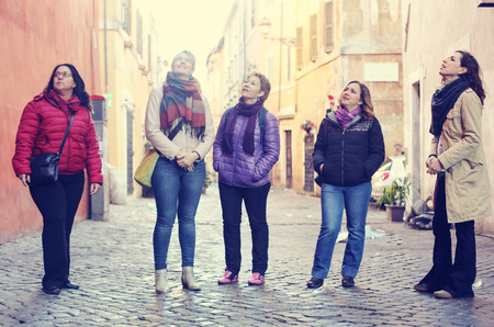 Women best friends smiling and walking at the city Stock fotó